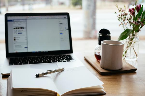 Student writing essay. Photo by nick morrison on unsplash